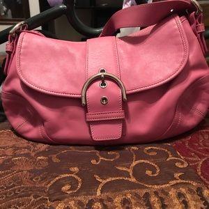 Colorful small coach hobo pink handbag.